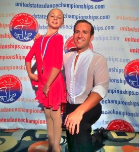 Grigol Kranz with his 8 year old student, Gillian Yoder, Champion at USDC